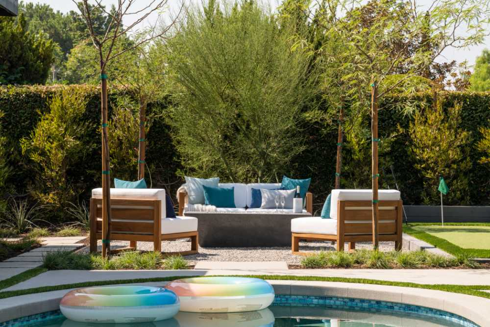 property brothers firepit and putting green